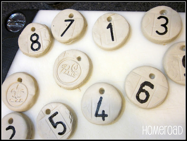 Tray of clay tags with numbers
