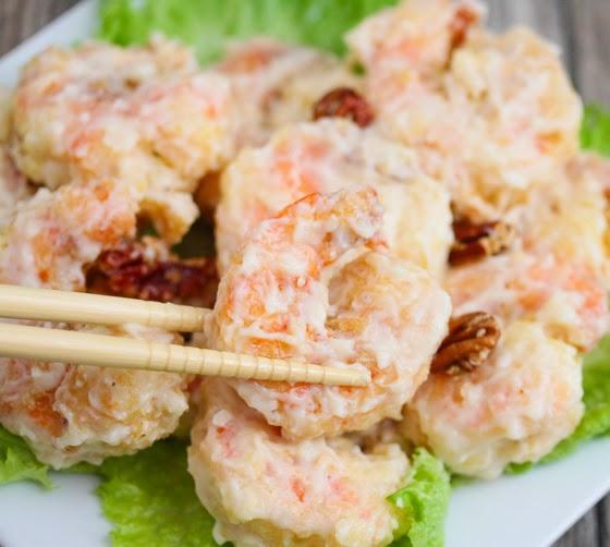 close-up photo of chopsticks picking up a shrimp