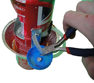 Bolt the bottle cap into place
