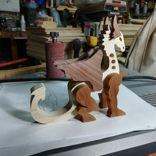 Handmade Wood Toy Dragon Clamps Removed