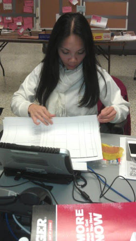 Christine Invencion working the numbers