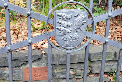 Studio Ghibli Museum Tour - she pointed out little details for us to notice, like the crest on the gate and on bricks here or there
