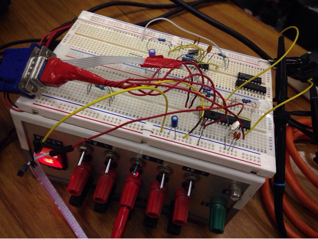 A PIC microcontroller and assorted components in a breadboard.  A VGA lead is connected to drive the monitor.