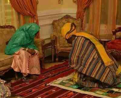Emir of Kano kneels before his mother