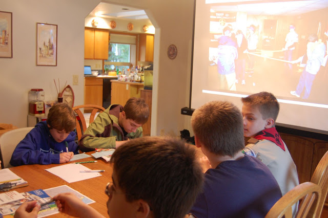 Filling out the old Bluecards while watching a slideshow of a previous Troop 101 activity.