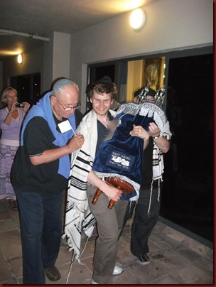 David W. carrying a Torah scroll at Beit Ariel Messianic Jewish congregation in Cape Town
