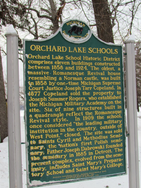 """Michigan Historical marker for Orchard Lake Schools Orchard Lake School Historic District comprises eleven buildings constructed between 1858 and 1924. The oldest, a massive Romanesque Revival house resembling a Norman castle, was built in 1858 by one-time Michigan Supreme Court Justice Joseph Tarr Copeland. In 1877 Copeland sold the property to Joseph Summer Rogers, who established the Michigan Military Academy on the site. Six of the nine structures built in a quadrangle reflect the Romanesque Revival style. In 1909 the school, once considered """"the leading military institution in the country, outside of West Point,"""" closed. The site was sold to Saints Cyril and Methodius Seminary, the nation's first Polish seminary, Father Joseph Dabrowski founded the seminary in 1885 in Detroit. The present complex, evolved from the seminary, includes Saint Mary's Preparatory School and Saint Mary's College."""