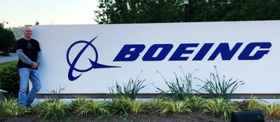 Me posed next to a Boeing sign