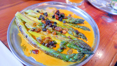 Bollywood Theater Portland Northwest meets Indian cuisine take of Grilled Asparagus with a rich curry made with fresh tumeric, green garlic, and cream topped with a sweet raisin and almond chutney