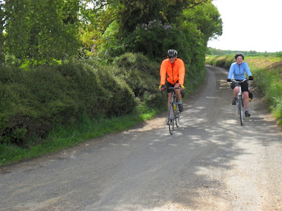 two cyclists approaching on lane