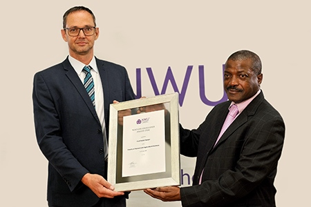 Prof Roelof Burger receives his award from Prof David Modise, executive dean of the Faculty Natural and Agricultural Sciences.