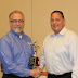 Reid Gibson, Vice President of Operations at The Robert E. Morris Company, is recognized for Excellence in Customer Service by Okuma America.