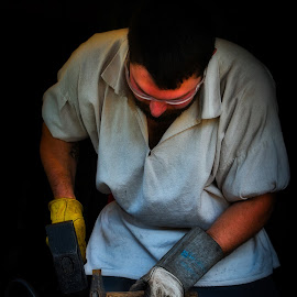 Melding Iron by Garry Dosa - People Professional People ( outdoors, person, hammering, indoors, working, man, summer, male, professional )