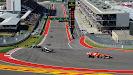 Fernando Alonso turns his Ferrari F138 into corner 1
