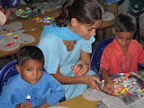 A PV helps primary school pupils with their art work.