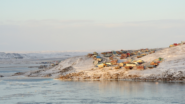 In the town of Iqaluit, all the buildings and roads were designed to sit on permanently frozen ground. But as temperatures rise, the permafrost is melting and homes are sinking. Photo: Saffron Blaze / Wikimedia Commons