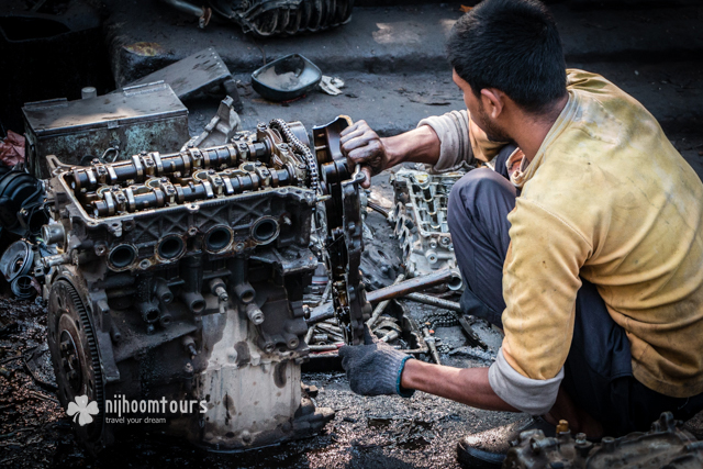 Tearing apart an old engine in Dholaikhal