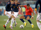 Chile's Alexis Sanchez (R) fights for the ball with Spain's Gerard Pique (L) and Sergio Busquets during a 2010 World Cup Group H match at Loftus Versfeld stadium in Pretoria June 25, 2010.   REUTERS/Eddie Keogh (SOUTH AFRICA  - Tags: SPORT SOCCER WORLD CUP)