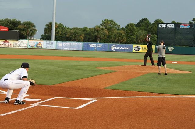 Attorney Emmanuel Ferguson throws out the first pitch before the baseball game.
