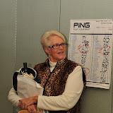 Sue Banaszak, Co-Chair holding raffle items
