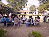 Students of the degree college enjoy a class outside in winter