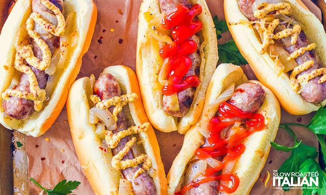 crockpot beer brats on buns with onions and ketchup or mustard