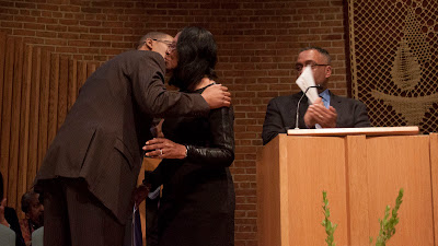 Theodora Smiley Lacey after giving the keynote address getting hugged by her son Clinton.   Photos by TOM HART.