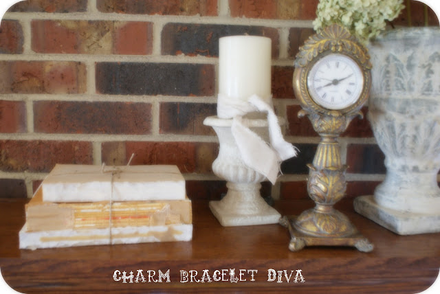 fireplace mantel deconstructed book decor vintage clock candle holder