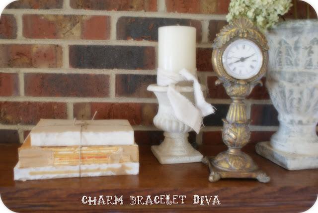 fireplace mantel deconstructed book decor vintage clock candle holder