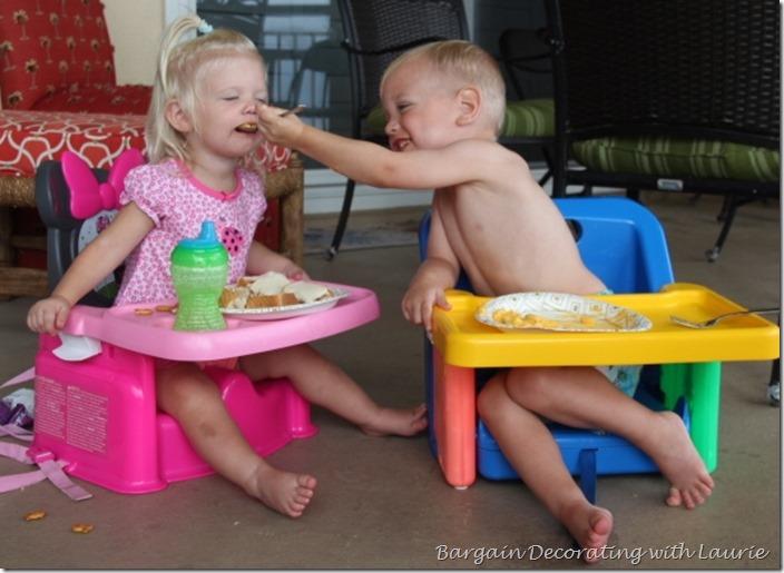 Brother sharing food with sister