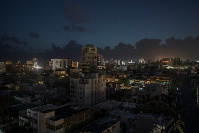 Most of the lights are off in San Juan, Puerto Rico, at 5:28am on 28 September 2017, after Hurricane Maria crippled the island's infradtructure. Photo: Victor J. Blue / The New York Times