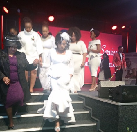 Simphiwe Ngema supported by Dumi Masilela's mother.