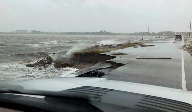 Wind and water from Hurricane Florence damages the highway leading off Harkers Island, N.C. on Friday, 14 September 2018. Photo: Jordan Guthrie / AP