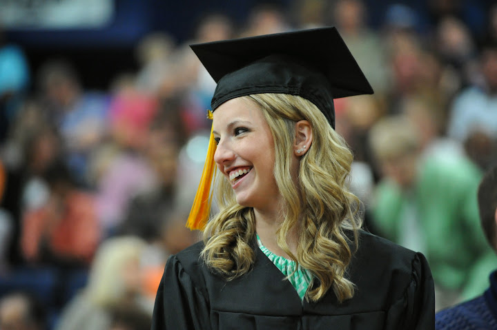 Girl in graduation gown smiling