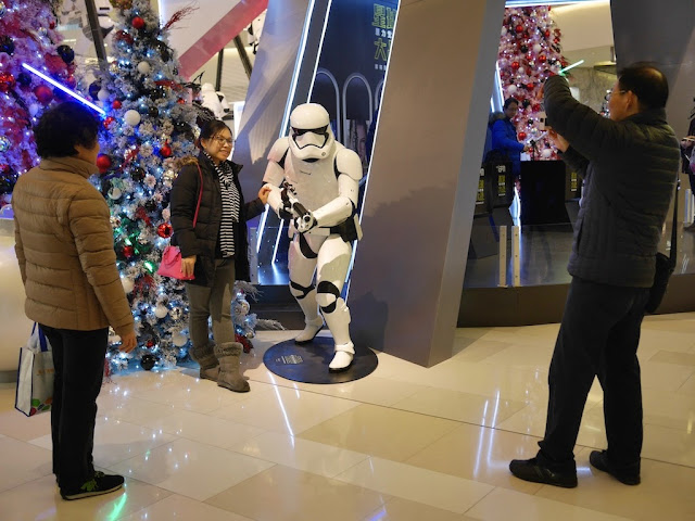 woman posing with a Star Wars stormtrooper at the IAPM shopping center in Shanghai