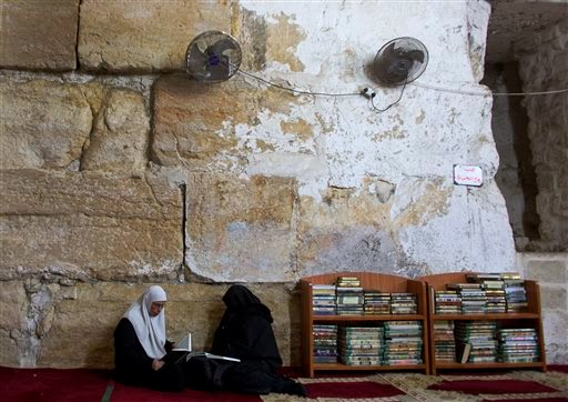 Old manuscripts get facelift at Jerusalem mosque