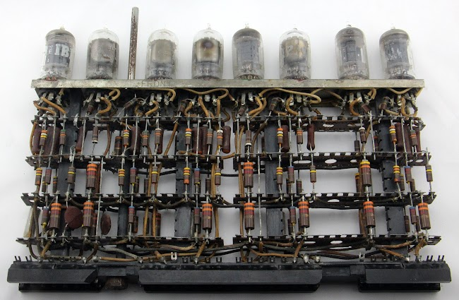 Front of an IBM tube module. This module contains five key debouncing circuits.