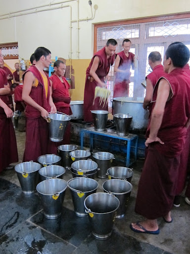 Putting the food into buckets in ordre to serve to the 2600 monks