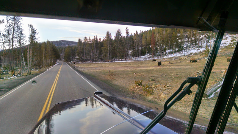 truckers view of the open road and snow covered mountains