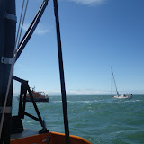 Yarmouth ALB towing a yacht with engine and steering failure towards the Solent on 11 May 2013. Taken from Poole ALB. Photo: RNLI/Poole Neil Ceconi