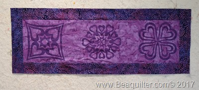 Purple batik table topper with prairie points3