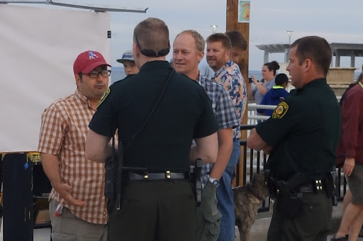 The heckler called the Police, but they sided with us and even told him to leave us alone. It's still legal to engage in free expression of ideas in the public square.