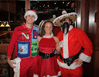 An elf (?), Ms. Claus and Pancho Claus
