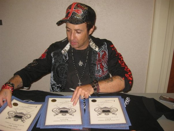 Vince Kelvin Signing Awards For The 2009 Pua Summit, Johnny Wolf