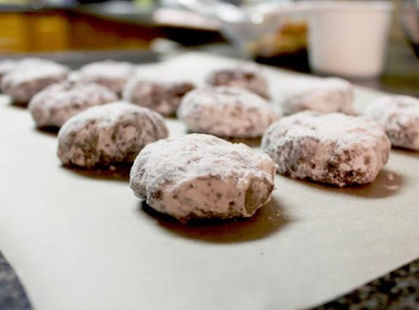 Add more powdered sugar to bag as needed.  Repeat until all cookies are...