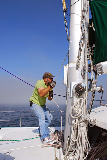 The Captain of the Gato Verde hoists the sails / Credit: Annette Bagley