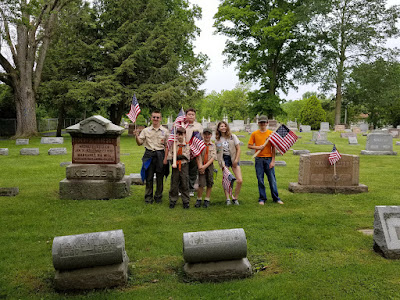 Boy Scout Troop 392 placing flags on the Veteran's graves at Grove City Cemetary