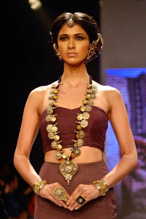 A model showcases a design by 'Apala' by Sumit Sawhney on Day 1 of India International Jewellery Week (IIJW), 2014 at Grand Hyatt, Mumbai.