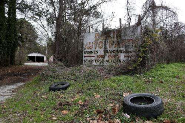 An overgrown sign in rural Alabama. Photo: IBT Media