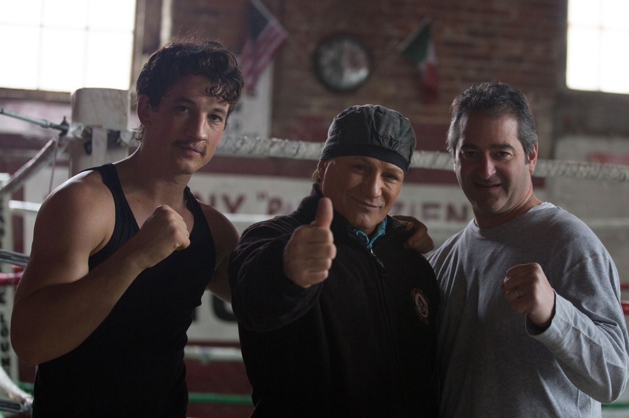 (L-R) Miles Teller, Vinny Paz and Producer Chad Verdi on the set of BLEED FOR THIS. (Photo by Seacia Pavao / Open Road Films).